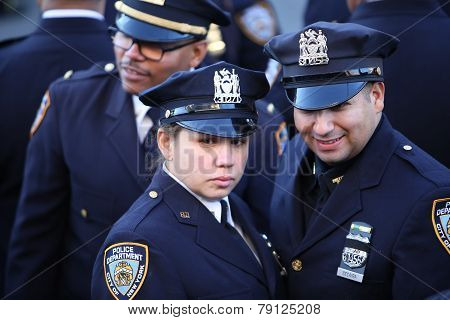 NYPD officers with black ribboned badges