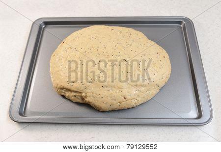 Risen Bread Dough On A Baking Tray