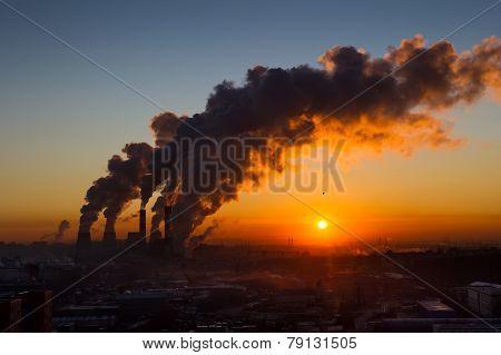 Pipes smoke at sunrise