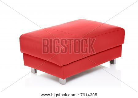A view of a red footstool