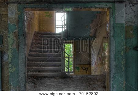 Old Staircase In An Abandoned Building