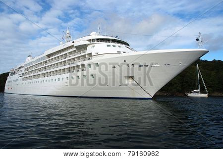 Luxury Cruise ship on the ancor next to island at sunny day poster