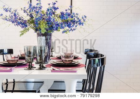 White Dinning Table With Black Chair In Dinning Room