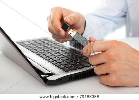 USB flash drive in the men's hands
