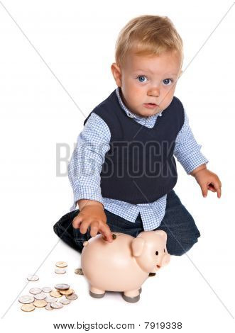 Toddler With Piggy Bank