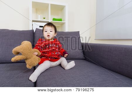 Little girl holding doll bear