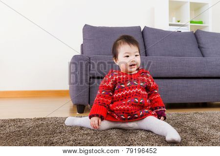 Baby girl doing legs splits on carpet