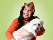 Smiling woman holding a small dog in her arms. poster
