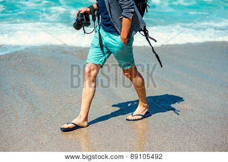 Man with photo camera on the beach