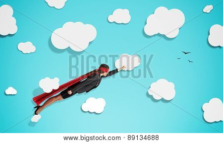 superwoman in red mask and cloak flying through paper clouds over blue background