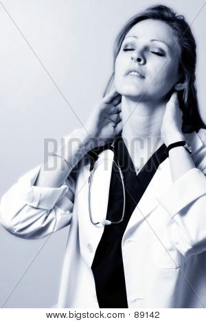 Lady Doctor Massaging Neck In Black And White
