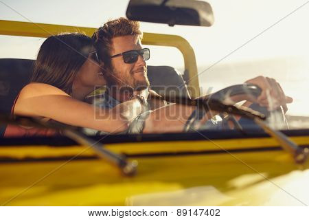 Romantic Young Couple Sharing A Special Moment On Road Trip