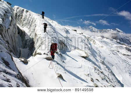 group of climbers on rope on glacier - sunny day on mountain poster