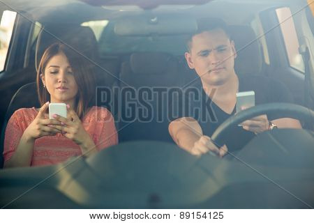Man And Woman Texting And Driving