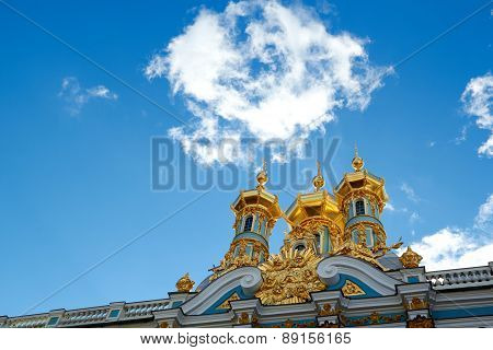Golden dome of Catherine Palace against bright sky in Pushkin, Russia