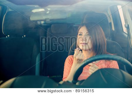 Putting On Makeup And Driving