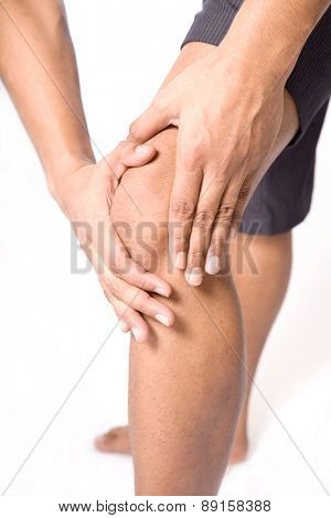 Man with both palm around knee cap to show pain and injury on knee area.