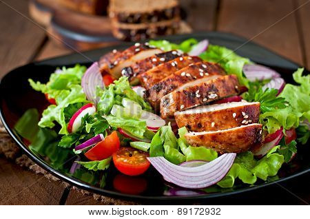 Fresh vegetable salad with grilled chicken breast