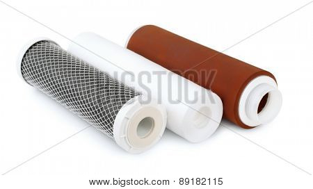 Three water filter cartridges isolated on white