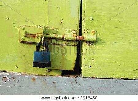 Padlock On A Green Painted Door