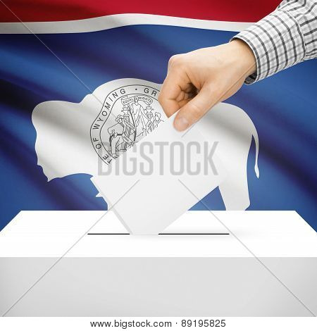 Voting Concept - Ballot Box With National Flag On Background - Wyoming