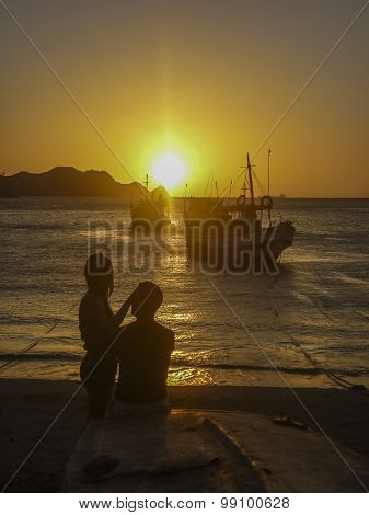 Young Couple And Sunset Beach