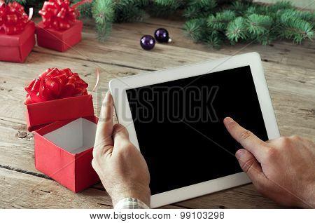 Tablet computer in men hands.