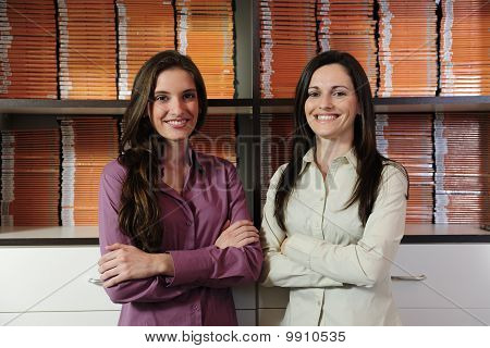 Young Businesspartners, Owners Of A Video Rental Store