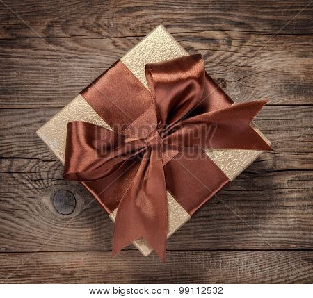 Beautiful Gift Box With A Bow On The Table
