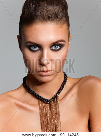 Portrait of a beautiful woman with necklace, isolated on white background . poster