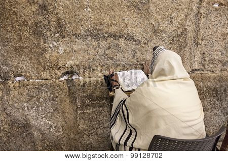 JERUSALEM, ISRAEL - JULY 16, 2015: Prayer prayes at Western Wall on Tisha B'Av - annual fast day in Judaism, commemorates anniversary of destruction of the First and Second Temples in Jerusalem.