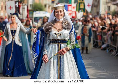 ALBA, ITALY - OCTOBER 05, 2014: Participant in historic noble dress on Medieval Parade - traditional part of celebration during annual White Truffle festival taking place each year on October in Alba.