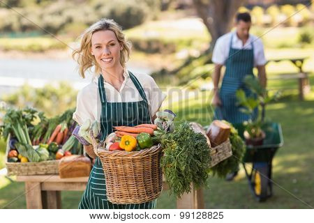 Portrait of a farmer woman holding a vegetable basket
