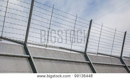 Fence around restricted area old jail in the Netherlands poster