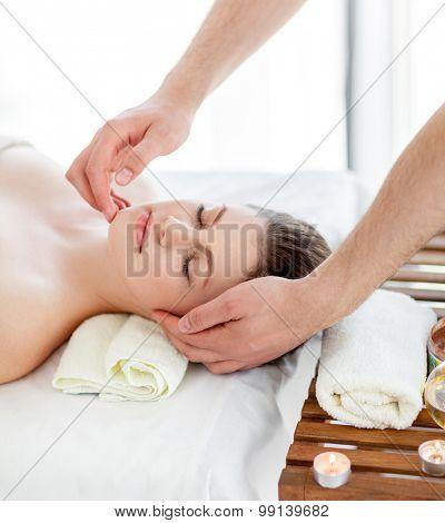 Portrait of beautiful woman in massaging room