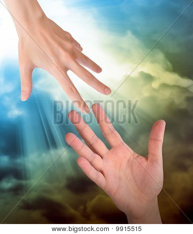 Hand Reaching for Safety Help in Clouds