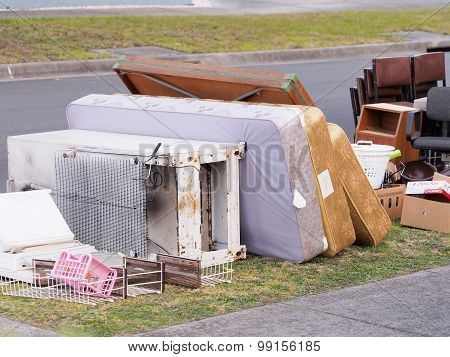 Matrasses and other items in front of middle class residential housing for the annual hard rubbish c