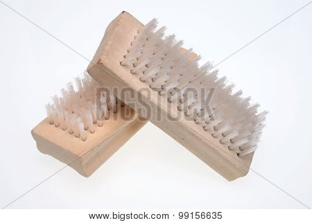 a nailbrush over white ground beauty product