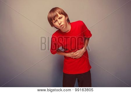 Boy teenager twelve years in the red shirt abdominal pain, gastritis, diarrhea retro poster