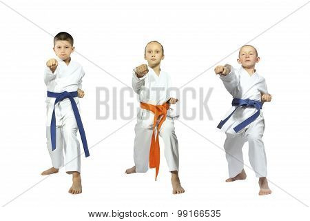 Three little sportsmen beats blow gyaku-tsuki