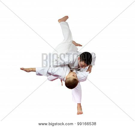 Two boys athlete are doing judo throws isolated