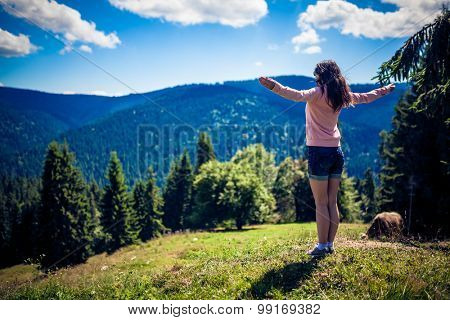 Woman Hiker in Romania enjoying the view