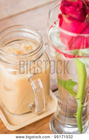 Iced Milk Coffee Serving On Wooden Table