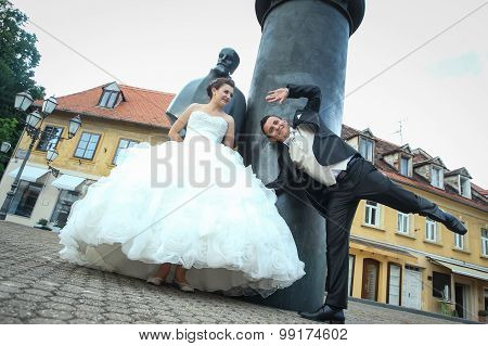 Bride And Groom Goofing In Front Of August Senoa Monument