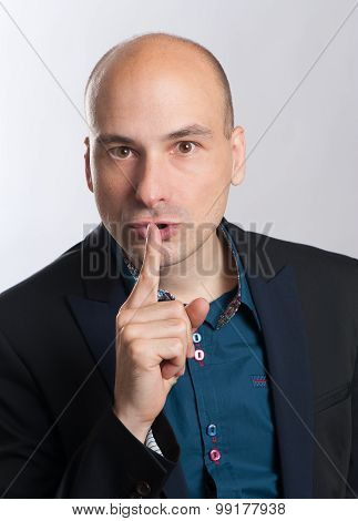 Bald Man With A Gesture Of Shh