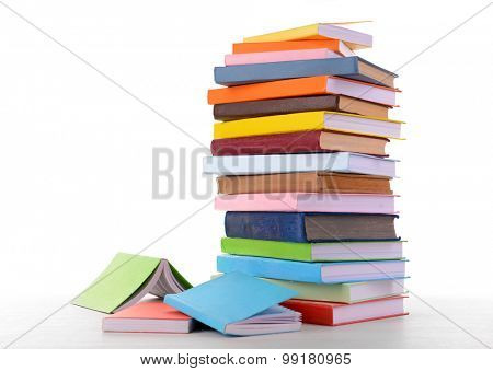 Heap of books isolated on white poster