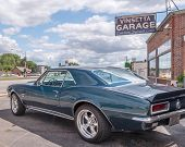 BERKLEY MI/USA - AUGUST 12 2015: A 1967 Chevrolet Camaro at the historic Vinsetta Garage at the Woodward Dream Cruise. Woodward is a National Scenic Byway. poster