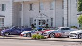ROYAL OAK MI/USA - AUGUST 13 2015: Three Team Penske Official Indy 500 pace cars at the Woodward Dream Cruise. Woodward is a National Scenic Byway. Woodward is a National Scenic Byway. poster