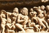Sculptures of loving couples illustrating the Kama Sutra on walls of Lakshmana Temple at Khajuraho in India Asia poster