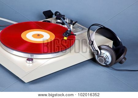 Analog Stereo Turntable Vinyl Record Player with Red Disk and Headphones